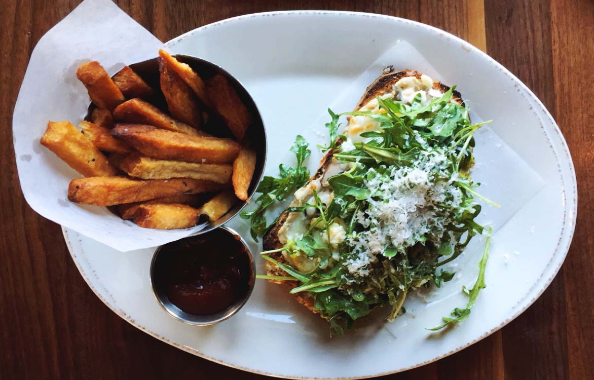 The mushroom tartine ($11 on the lunch menu): hummus, grilled mushrooms, mozzarella, avocado, arugula, and parmesan with a side of batatas fritas.