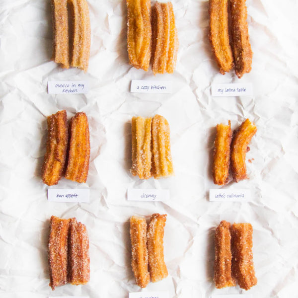 9 churros cut in half on a white background