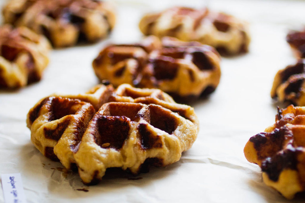 angled shot of liege waffles on a white background
