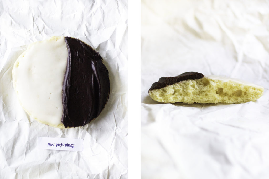 black and white cookie next to half a cookie